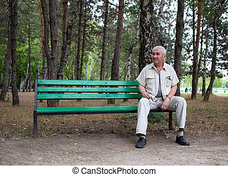 Old man sitting on the bench.