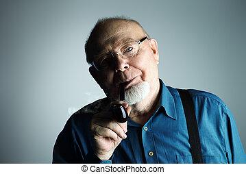 old man smoking a pipe