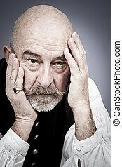 old man sorrow - An old man with a grey beard is hopeless