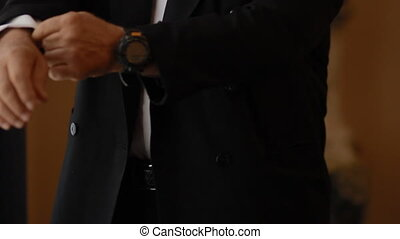 Old man straightens his suit