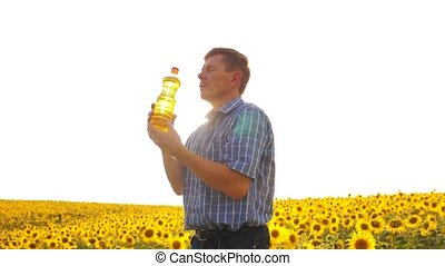 old man sunlight farmer sunflower oil concept agriculture....