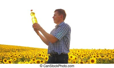 old man sunlight farmer sunflower oil concept agriculture....