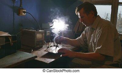 old man technician radio solder iron retro soldering - old...