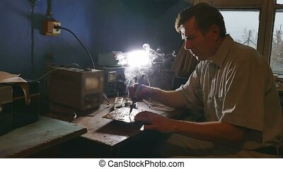 old man technician radio solder retro iron soldering - old...
