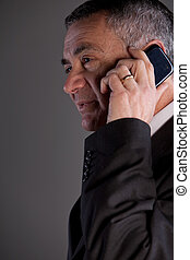 old man using a mobile phone