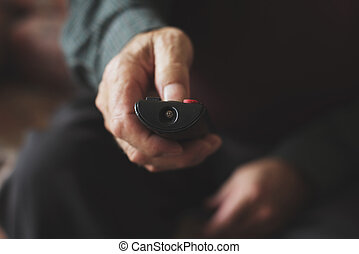 old man using a remote control