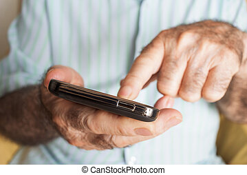 old man using a smartphone