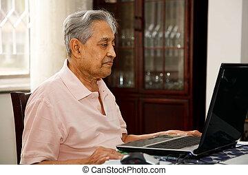 Old man using internet