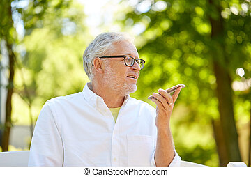 old man using voice command recorder on smartphone - ...