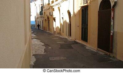 Old man walking in street