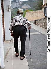 Old Man Walking on Aisle with Cane - Senior Man with Bent...
