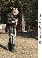 old man walking on the garden