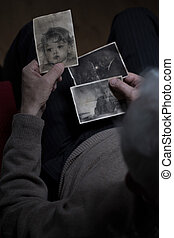 Old man watching pictures