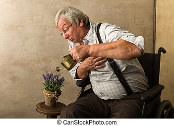 Old man watering plant