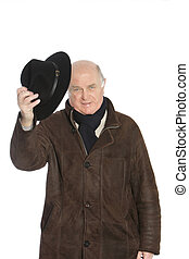 Old man wearing coat and holding a hat against the white background
