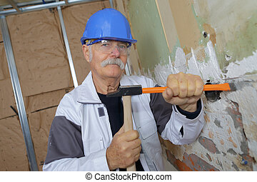 old man with a chisel and hammer