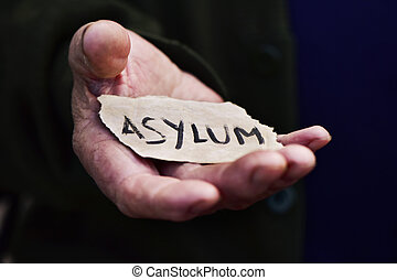 old man with a paper with the word asylum