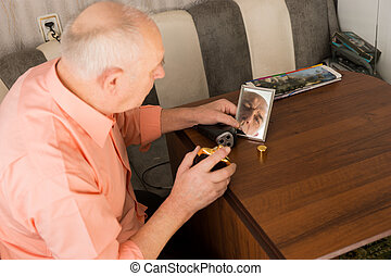 Old Man with Aftershave Looking at the Mirror