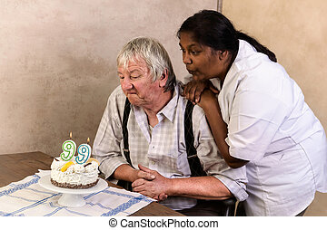 Old man with birthday cake
