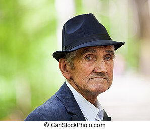 Old man with hat outdoor