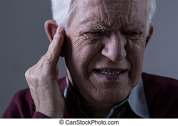 Old man with tinnitus - Old man suffer from tinnitus