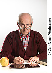 old man works with documents