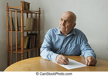 Old man writing notes or deciding to sign