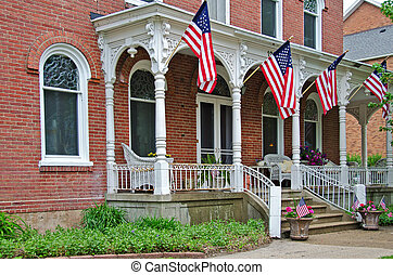 old mansion with American flags