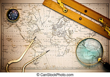 Old map and navigational objects. - Photo of an old hand...