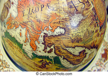 Old map of the world on the globe