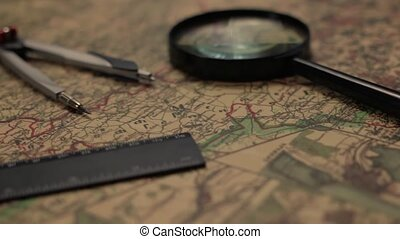 Old map with magnifier, divider and ruler