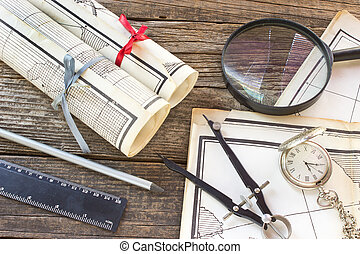 Old Maps with tools on wooden background