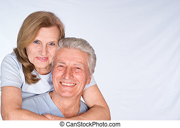 beautiful elderly couple in a light clothes
