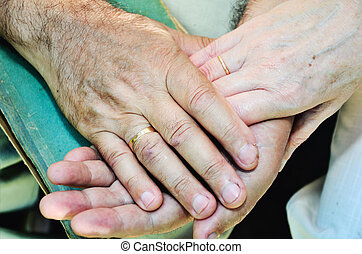 old married couples hands. horizontal format