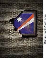 Old Marshall Islands flag in brick wall