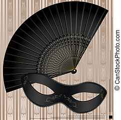 old mask and fan - on beige background are old-fashioned...