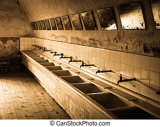 Old mass bathroom in prison