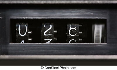 old mechanical counter counts numbers from 0 to 2350 - macro