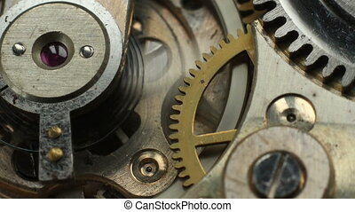Old mechanical watch mechanism macro time lapse.