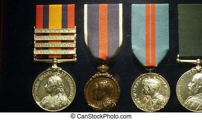 Old medals displayed on the Tower of London
