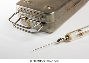 old medical syringes and metal box