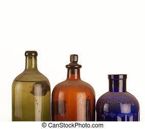 Old medicine bottles on white