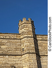 Old medieval english city wall with tower