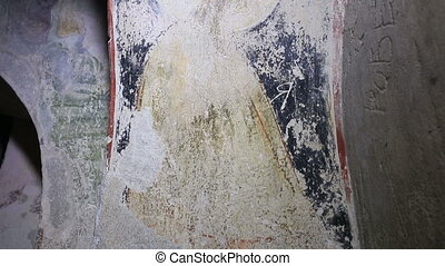 Old medieval faded murals at the church