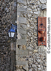 Old medieval lantern on a stone wall