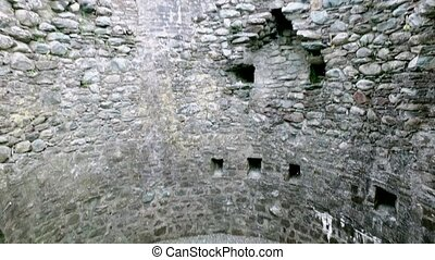 old medieval tower with loopholes inside - ancient monument,...