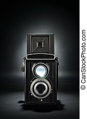 Old medium format camera on black - Old fashion twin-lens ...