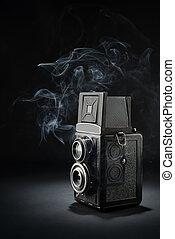 Old medium format camera on black - Old fashion twin-lens ...