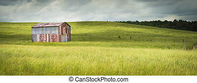 Old Metal Barn in a Field