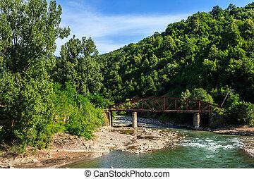 old metal bridge at the river fork - old rusty metal bridge...